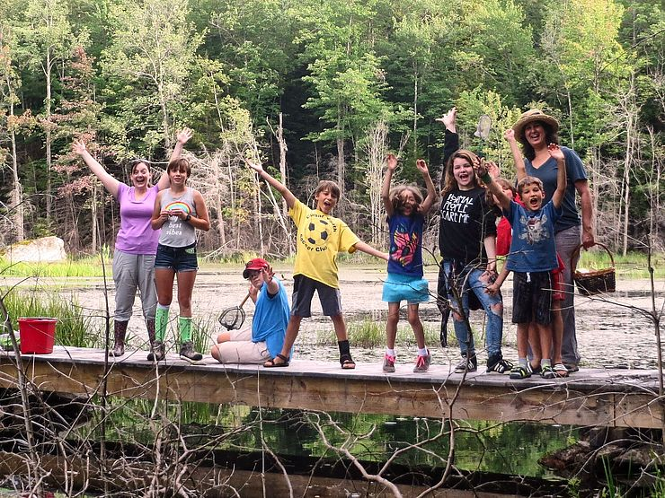 Group of kids on small footbridge