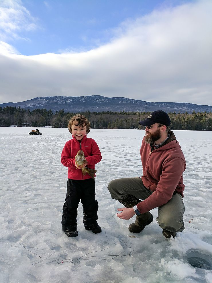 Henry Owens and Rick Brackett showing off their ice-fishing catch